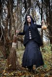 A woman in a witch suit in a forest Royalty Free Stock Images