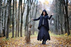 A woman in a witch suit in a forest Royalty Free Stock Image