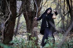 A woman in a witch suit in a forest Royalty Free Stock Photo