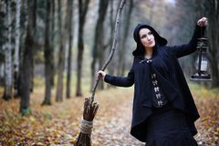 A woman in a witch suit in a forest Royalty Free Stock Photography