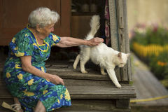 Free Woman With A Cat Sitting On The Porch Of The House. Stock Photos - 75250403