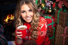 Free Woman With A Cup Near The Christmas Tree Stock Images - 180678674