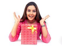 Woman With A Gift Box Royalty Free Stock Images