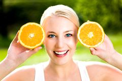 Woman With An Orange Stock Photo
