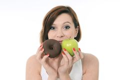 Woman With Apple And Chocolate Donut In Hands Stock Photography