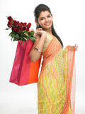 Woman With Bag Full Of Red Roses Royalty Free Stock Images