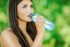 Woman With Bare Shoulders Drinks Royalty Free Stock Photography