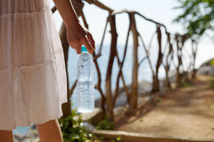 Woman With Bottle Of Cold Water Royalty Free Stock Photography