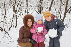 Woman With Boy And Girl In Winter In Wood Royalty Free Stock Photos