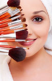 Woman With Brushes For Make-up Stock Photo