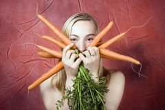 Free Woman With Carrots Stock Photography - 4627002