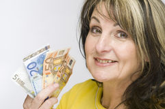 Woman With Cash Royalty Free Stock Photos