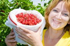 Woman With Cherries Stock Images