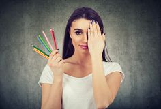 Free Woman With Colorful Crayons On Wall Background Stock Photography - 156643062