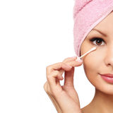 Woman With Cotton Swab. Skincare