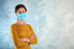 Free Woman With Disposable Mask On Face Against Blue Background. Space For Text Stock Photography - 169979752