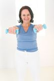 Woman With Dumbbell Royalty Free Stock Images