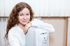 Woman With Electric Radiator Stock Photo