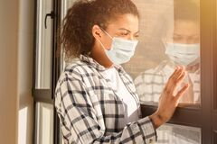 Free Woman With Face Mask Would Like To Go Out The Home. Concept Of Pandemic Of Covid-19 Coronavirus Stock Photo - 217749450