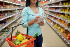 Free Woman With Food In Shopping Basket At Supermarket Royalty Free Stock Image - 84353206