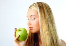 Woman With Green Apple. Stock Photo