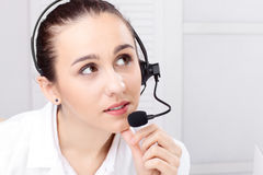 Woman With Headset Over White Background Royalty Free Stock Photography