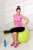 Woman With Hip Pain During Workout Royalty Free Stock Image