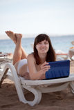 Woman With Laptop At Resort Beach Stock Image