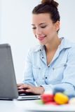 Woman With Laptop Working At Home Stock Photo