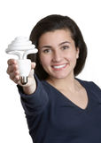 Woman With Light Bulb Stock Photography