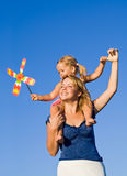 Woman With Little Girl Playing Outdoors Stock Photos