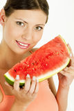 Woman With Melon Stock Photo