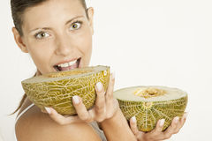 Woman With Melon Stock Photos