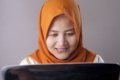 Free Woman With Naughty Expression Looking At Laptop Stock Photos - 147743903