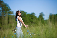Woman With Old-fashioned Bike In Summer Meadow Royalty Free Stock Photos
