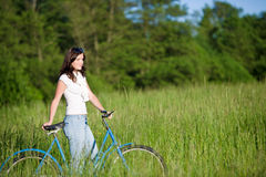 Woman With Old-fashioned Bike In Summer Meadow Stock Image