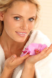 Woman With Orchid Stock Images