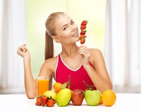 Woman With Organic Food Eating Strawberry Royalty Free Stock Image