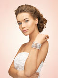 Woman With Pearl Earrings And Bracelet Stock Images
