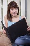 Woman With Photo Album On Sofa Stock Photography