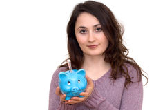 Woman With Piggybank Royalty Free Stock Images
