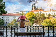 Woman With Red Hat Enjoys The View To The Castle Of Prague, Czech Republic Stock Photography