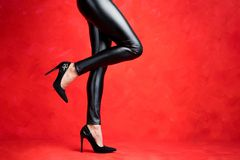 Free Woman With Sexy Legs Wearing Black Leather Pants And Black High Heel Shoes Royalty Free Stock Image - 157722476