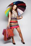 Woman With Shopping Bags And Umbrella Royalty Free Stock Images