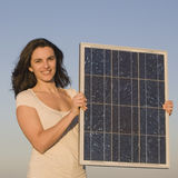 Woman With Solar Panel During Sunset Stock Photo