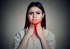 Woman With Sore Throat Touching Her Neck Colored In Red Stock Photography
