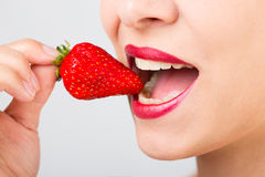 Woman With Strawberry Stock Images