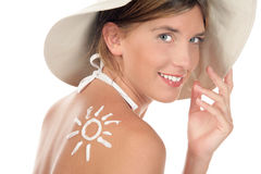 Woman With Suntan Lotion Royalty Free Stock Photography