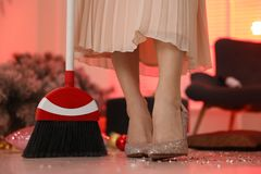 Free Woman With Sweep Broom Cleaning Messy Room After New Year Party, Closeup Royalty Free Stock Photos - 164215628