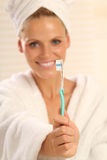 Woman With Toothbrush Stock Photos